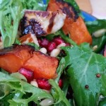 Behold, roasted sweet potato with salad leaves, pomegranate, haloumi, and…
